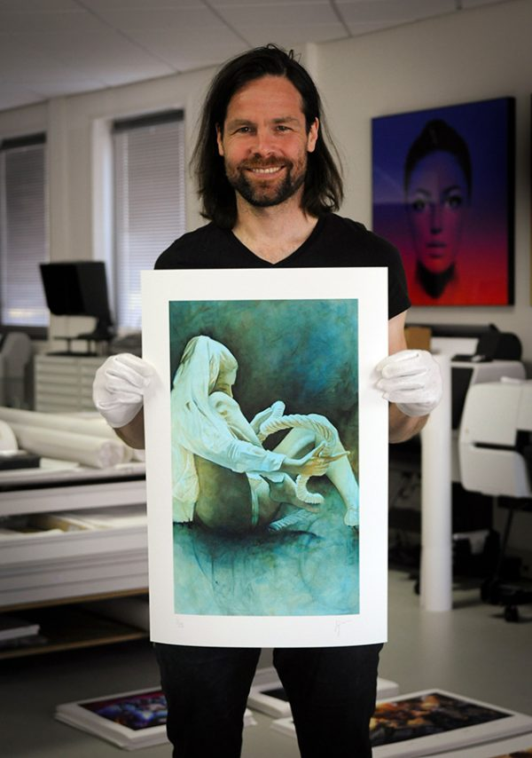 Daan Noppen standing with limited edition print Fabric VI